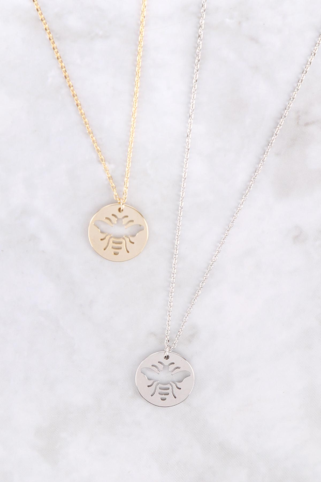 Riah Fashion Brass-Bee-Cutout-Coin-Pendant-Necklace - Side Cropped Image