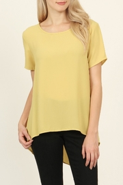 Riah Fashion Solid Surplice Back-Blouse - Front cropped