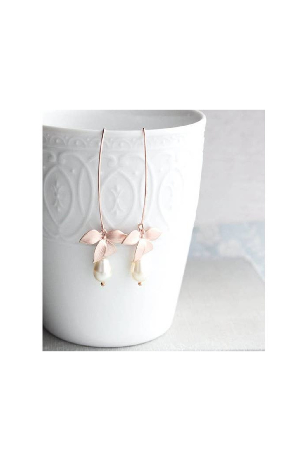 The Birds Nest Rose Gold/Ivory Long Orchid Earrings - Main Image
