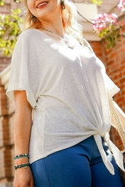 Umgee  Short Rolled Sleeve Slub Knit V-Neck Top with Front Tie and Scoop Hem Curvy - Product Mini Image