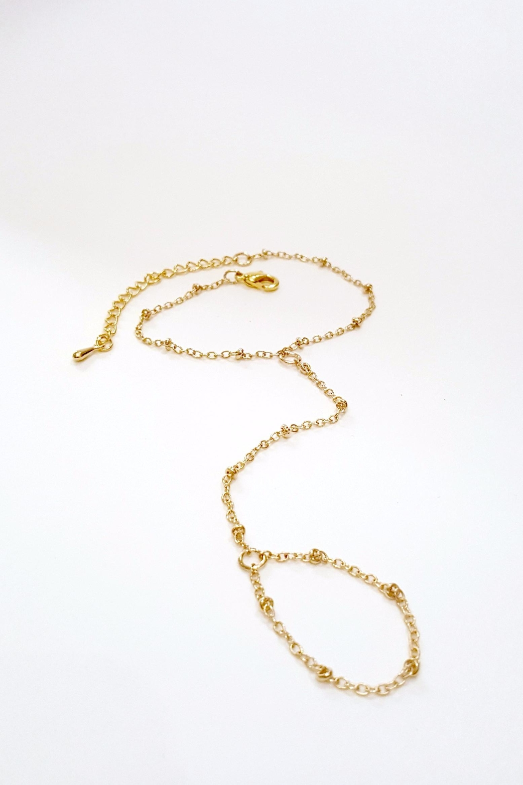 Simply Chic Gold Hand-Chain Bracelet - Back Cropped Image
