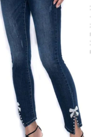 Frank Lyman  Slightly distressed jean with bow - Product Mini Image