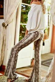 Pretty Little Things Snakeskin Flare Pants - Front full body