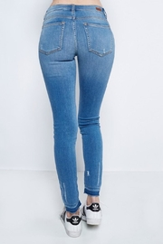 Sneak Peek Skinny Unfinished Jean - Side cropped