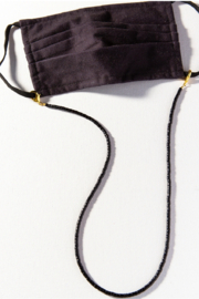 Ink + Alloy Solid Coconut Mask Necklace - Front cropped