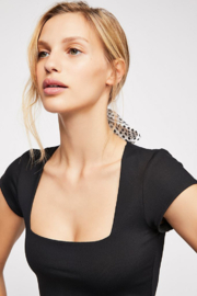 Free People Stretchy American made bodysuit featuring a square neckline. - Back cropped