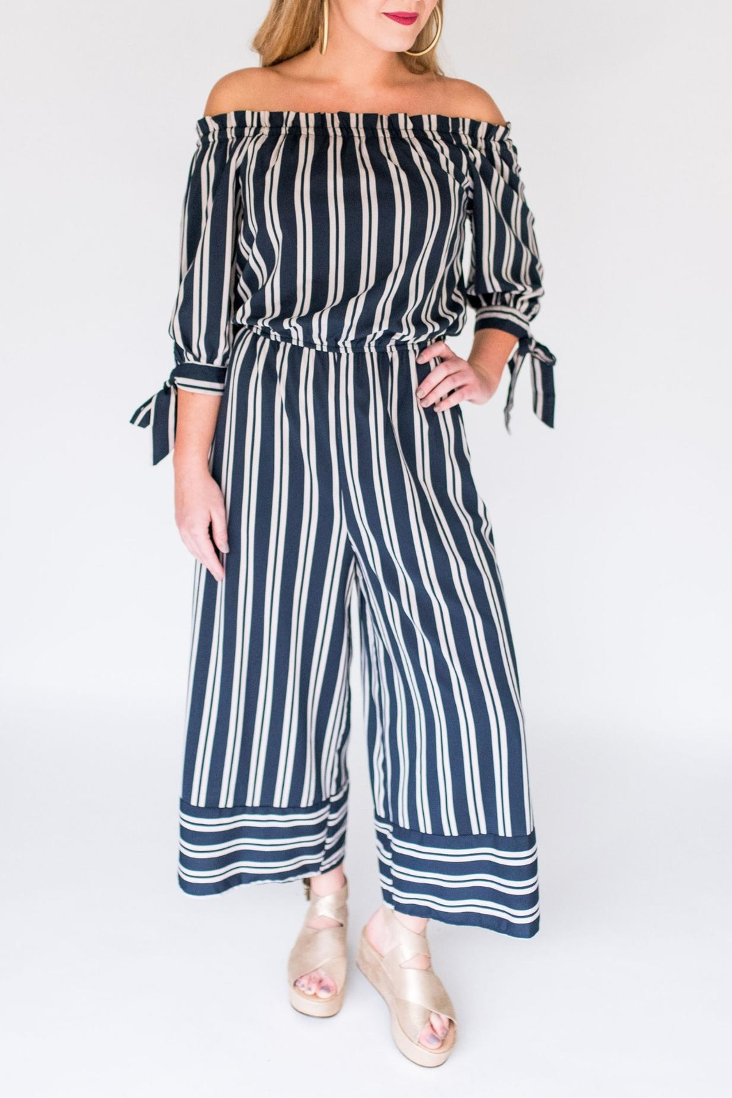 02a17e2e234c6 She + Sky Stripe Culotte Jumpsuit from New York City by Suite275 ...
