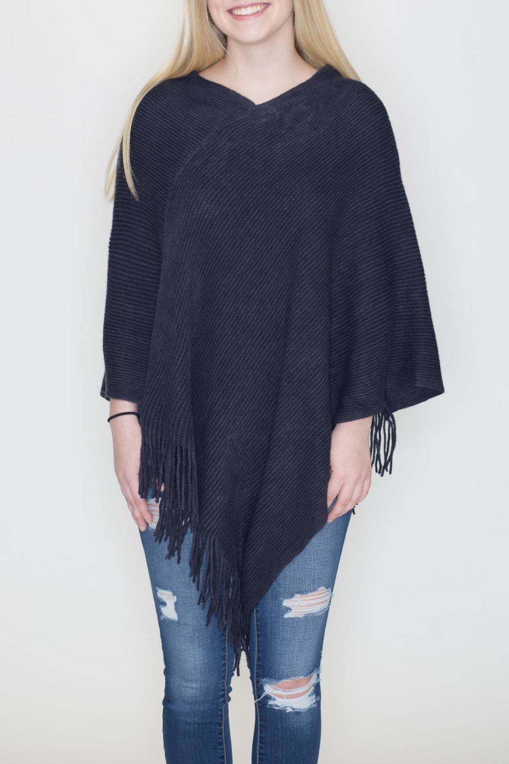 6adfcbbc800 Ruggine Striped Knit Poncho from Philadelphia by May 23 — Shoptiques
