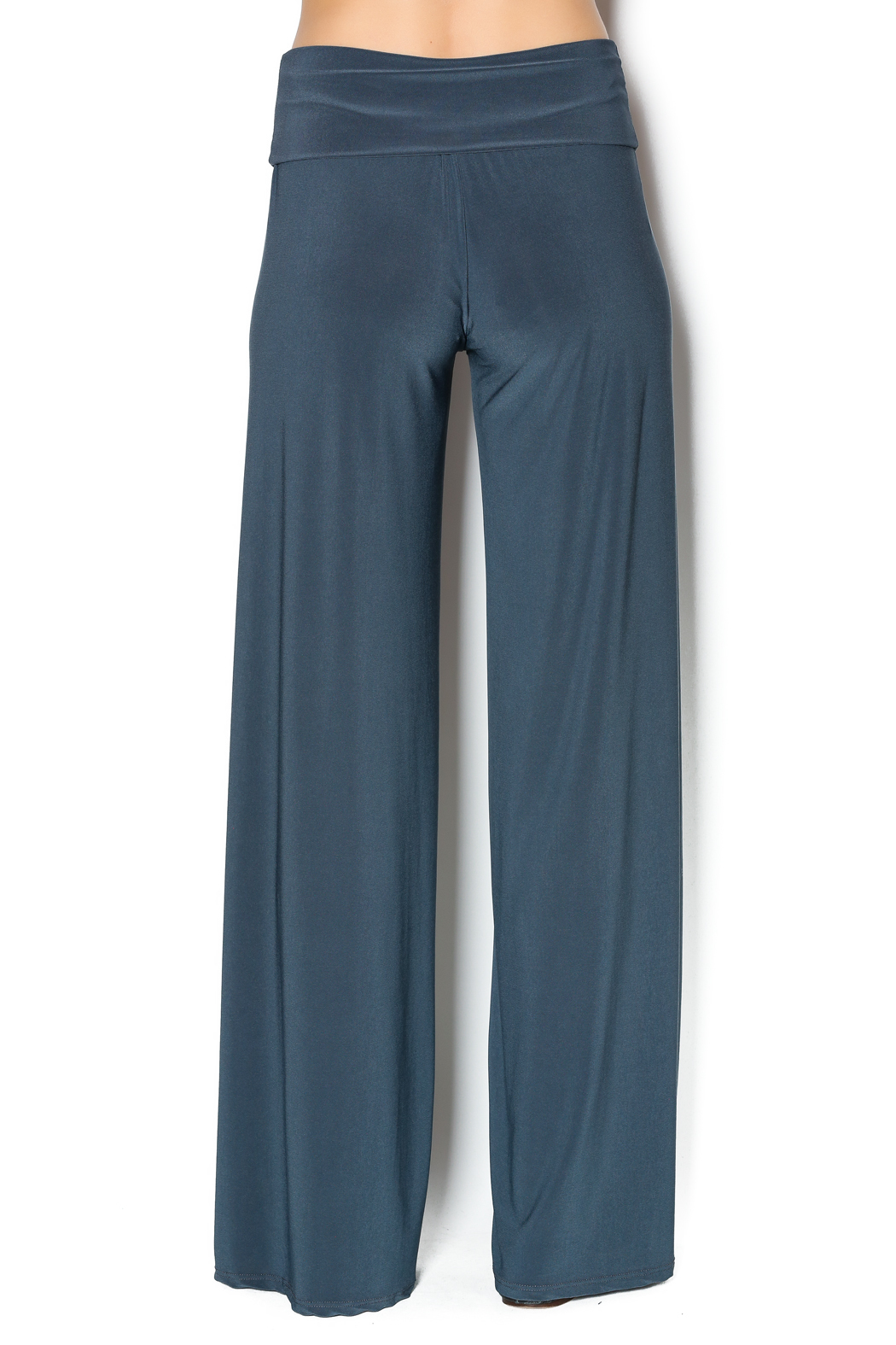 Everywhere you look, palazzo pants are making a comeback. You see them on the street, at a party, at the beach, in the office and even at weddings. Hugely popular in the 60s and 70s, it's easy to see why everyone loves them now.