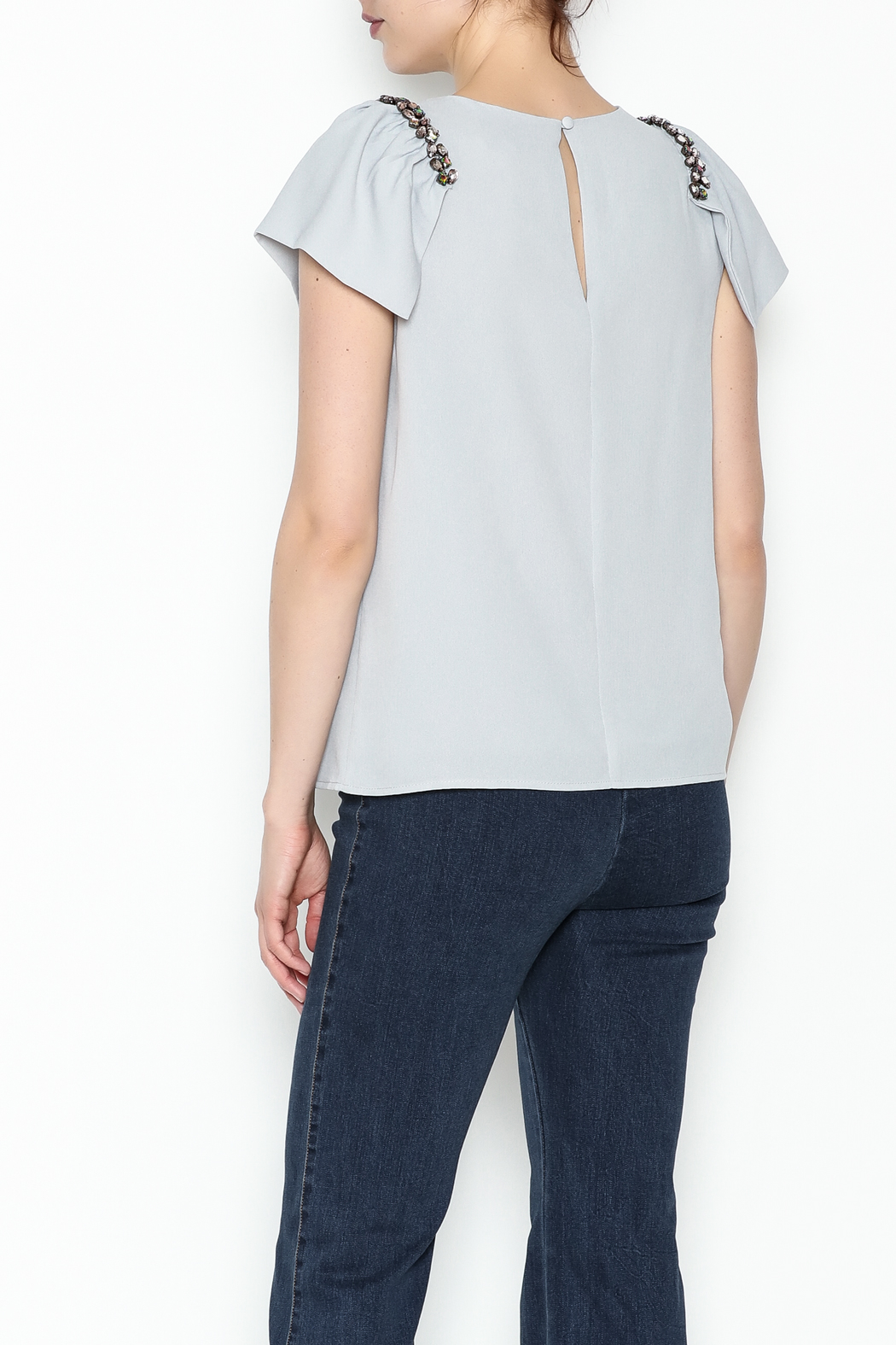 the clothing company Gray Flutter Top - Back Cropped Image