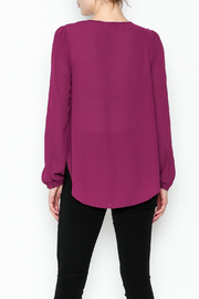 the clothing company Purple Embellished Blouse - Back cropped