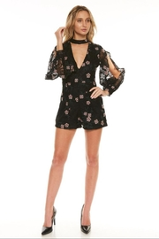 the clothing company Black Floral Romper - Front cropped