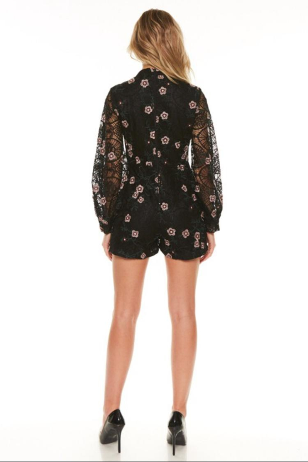 the clothing company Black Floral Romper - Front Full Image