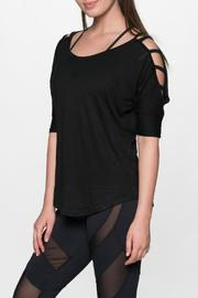 THE FREE YOGA Rocker Ladder Sleeve Top - Front cropped