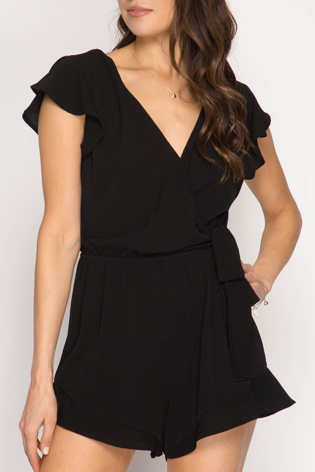 55286b730c68 She + Sky V-Neck Ruffle Romper from New York City by Suite275 ...