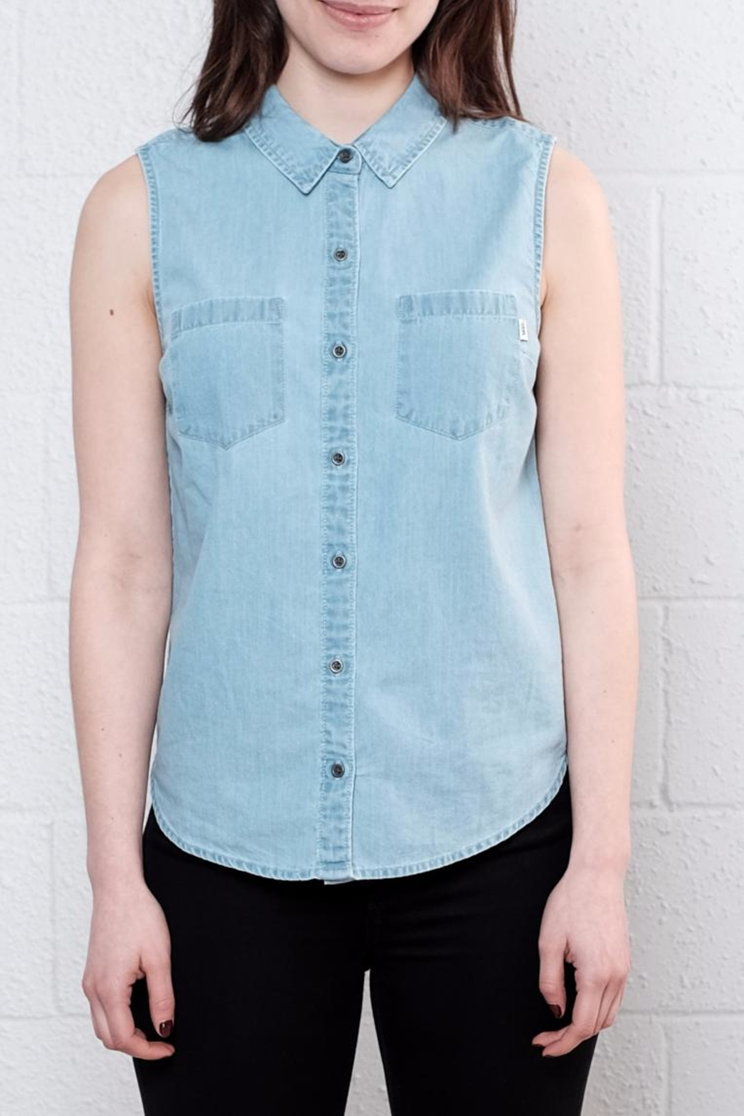 Meetings, lunch dates, and after hours cocktails could all use the Courtesy Collar Blue Chambray Top! Deep blue chambray is perfectly lightweight across a collared neckline, and sleeveless, darted bodice with hidden button placket (and slit at back).