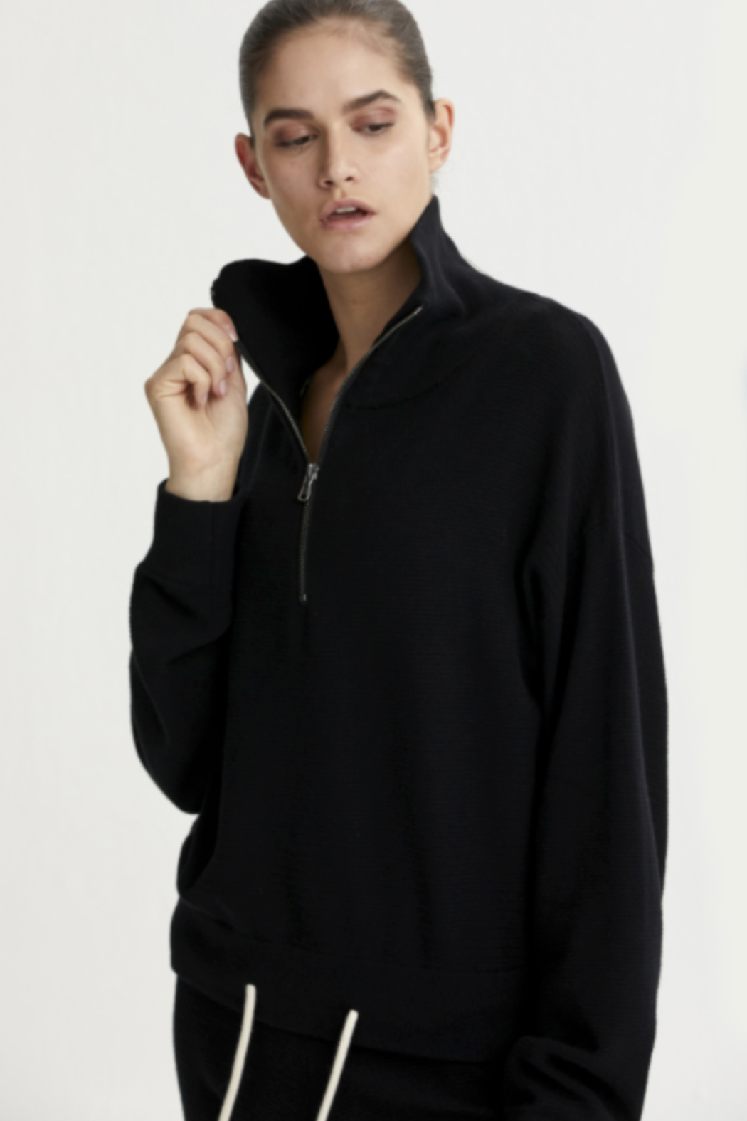 Varley black half zip sweater with draw string at the bottom - Front Full Image