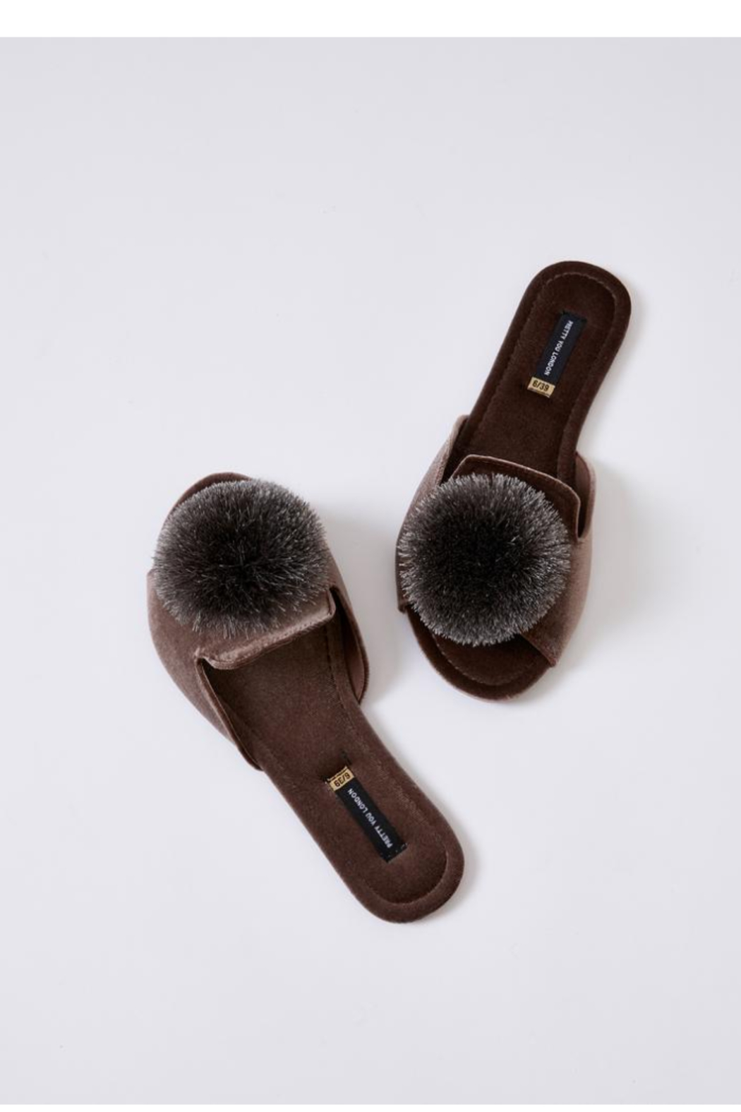 The Birds Nest VELVET POM SLIPPERS - Front Cropped Image