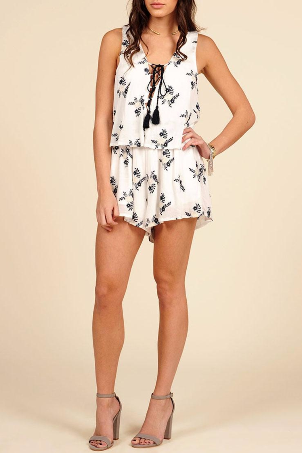 60c18f267787 Vintage Havana Embroidered Lace Up Romper from Orange County by ...