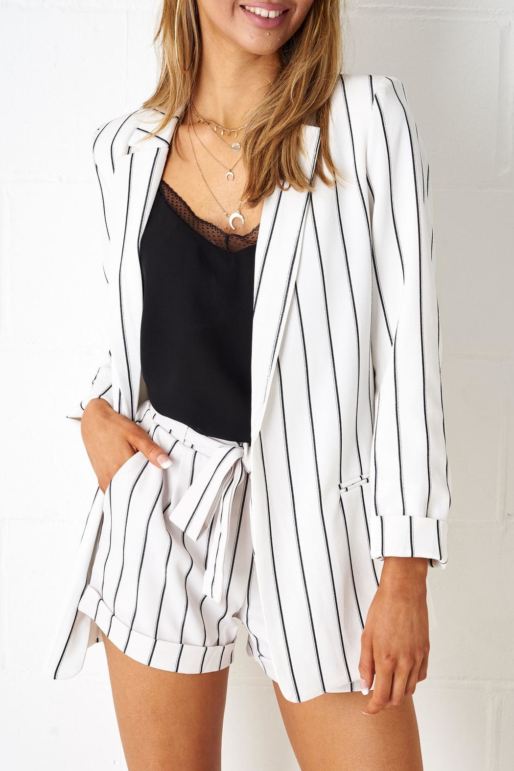 05578a99c1d8b6 frontrow White Pinstripe Blazer from Essex by Frontrow — Shoptiques