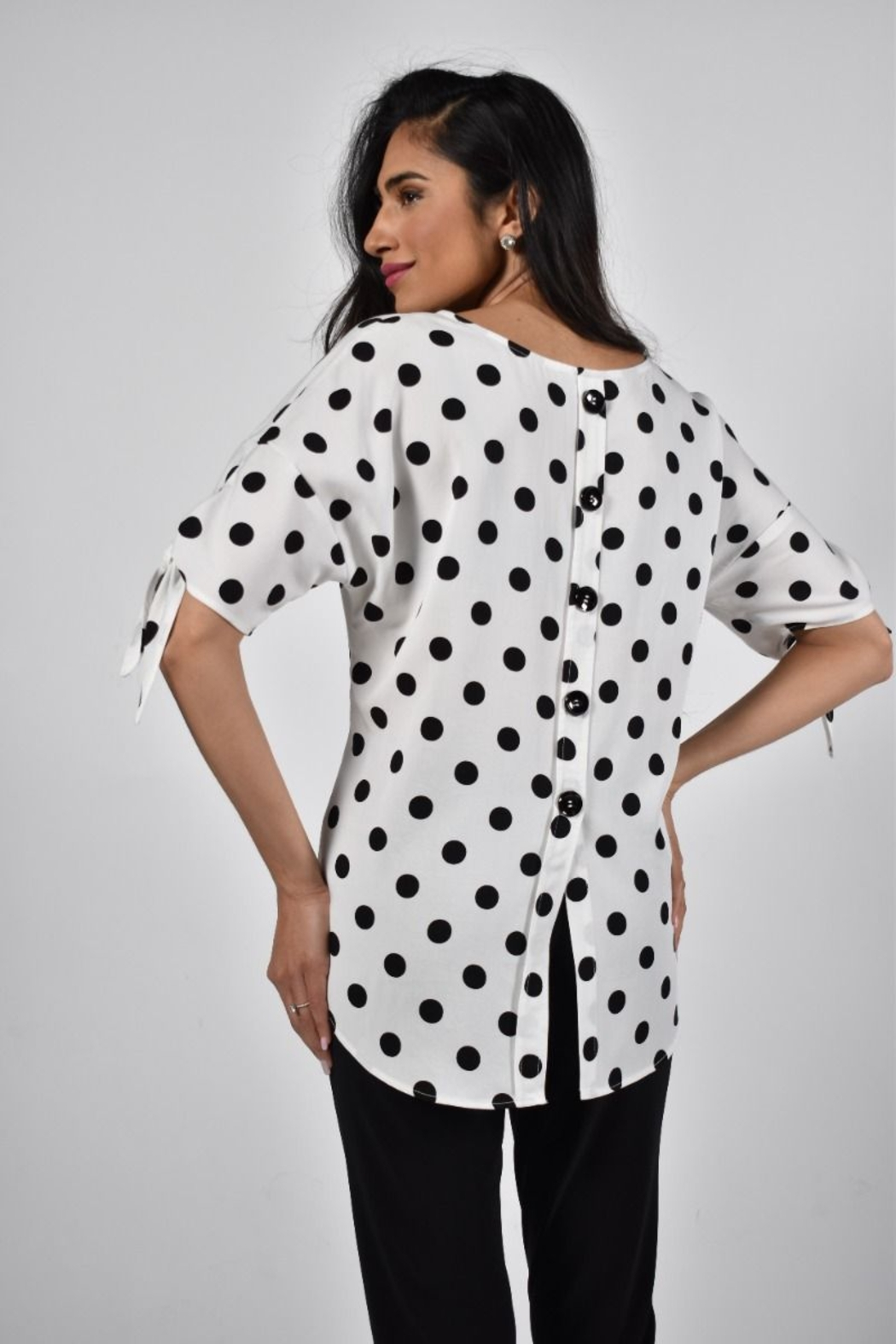 Frank Lyman  White with black polka dots woven top. - Front Full Image