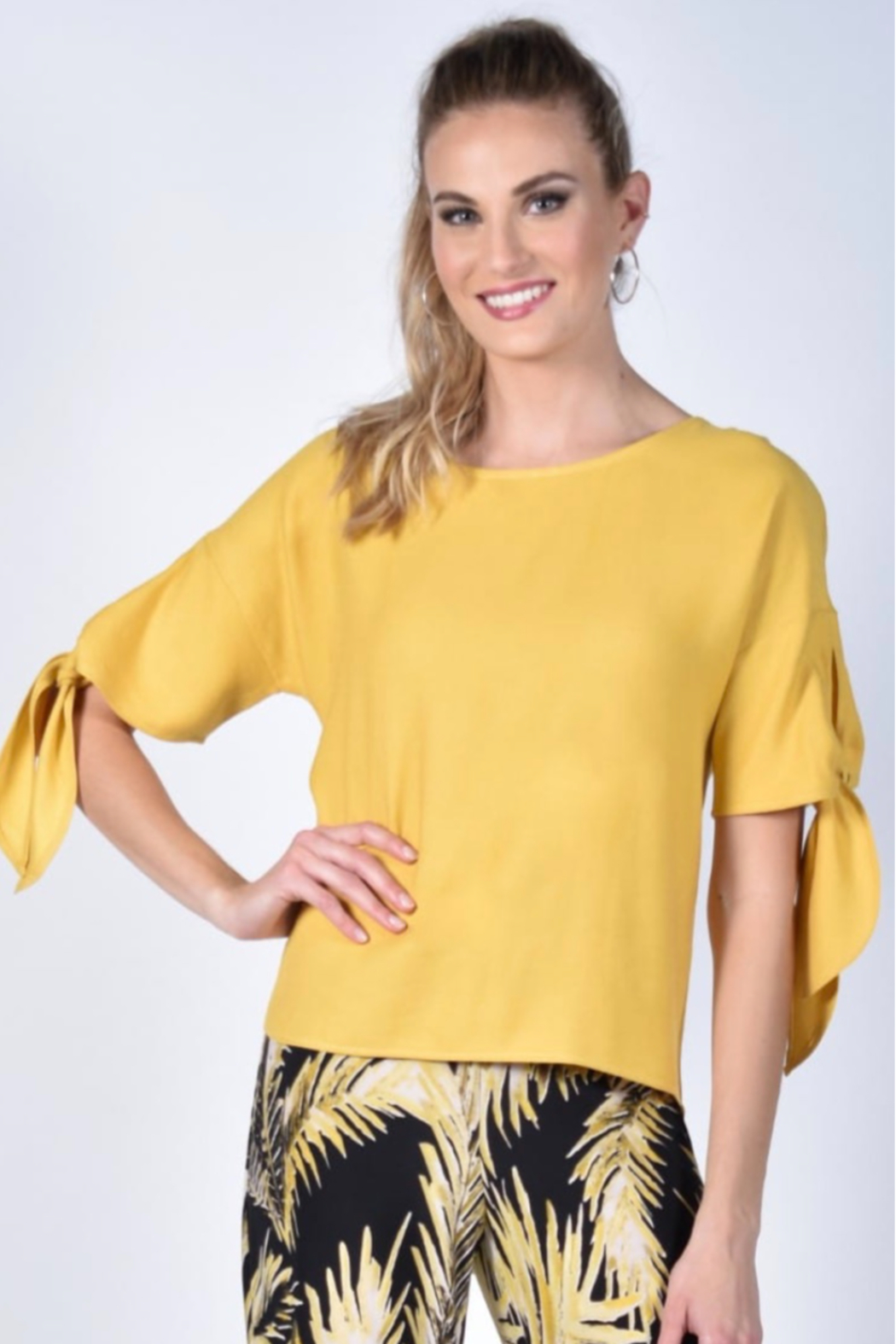 Frank Lyman  Yellow scoop neck top, with tie on sleeves. Button detail down back. - Main Image
