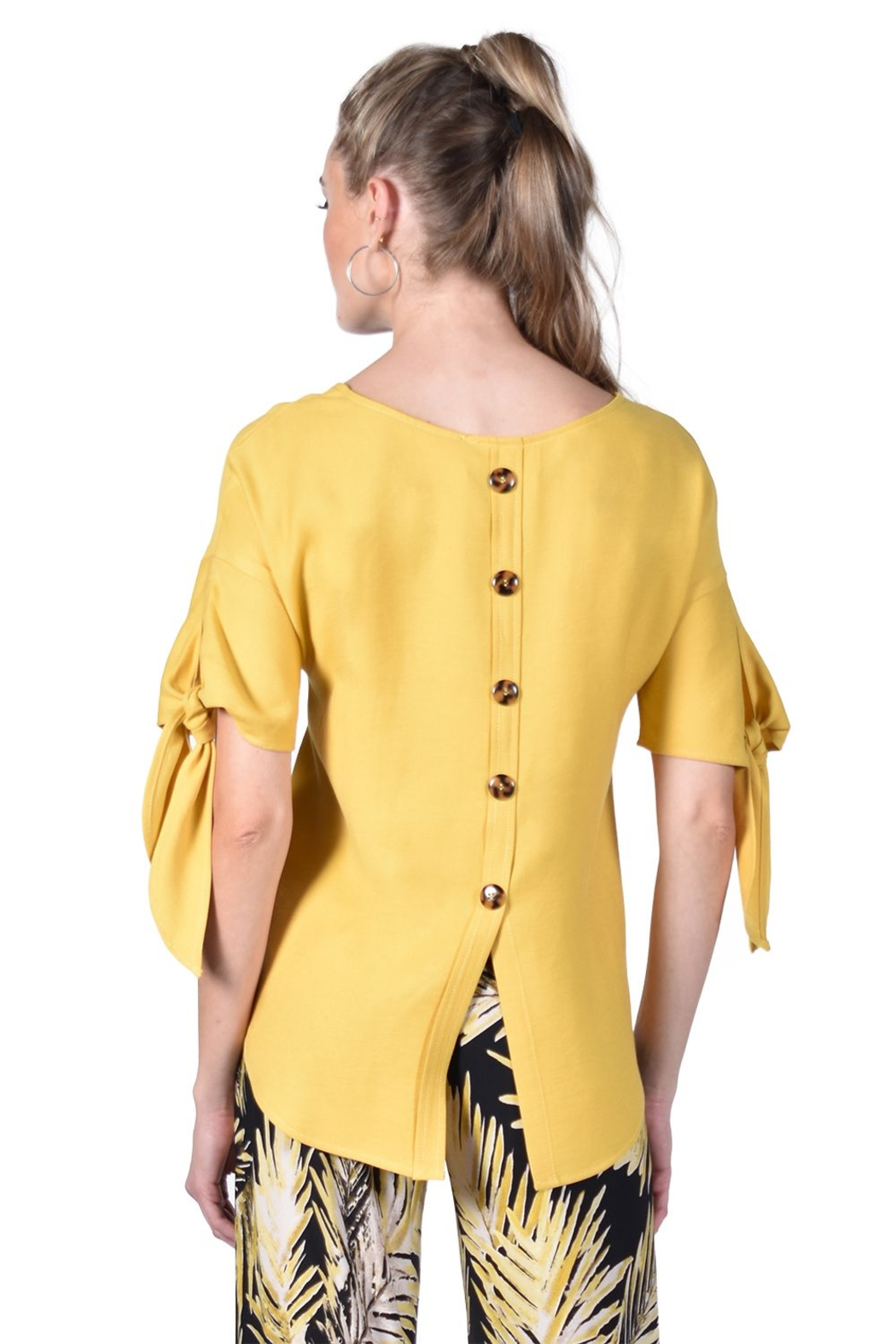 Frank Lyman  Yellow scoop neck top, with tie on sleeves. Button detail down back. - Front Full Image