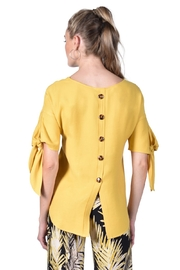 Frank Lyman  Yellow scoop neck top, with tie on sleeves. Button detail down back. - Front full body