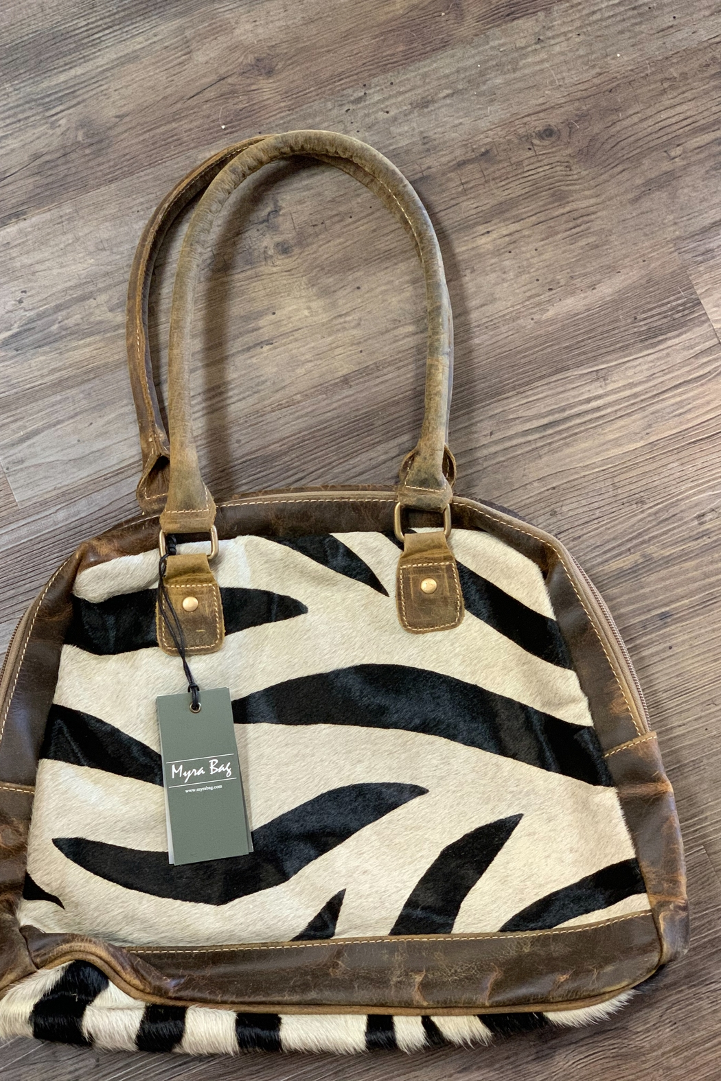 Myra Bag Zebra Style Hairon Bag From Georgia By Charming Chics Boutique Shoptiques Canvas, 1 compartment, 1 zipper pocket, 2 open pockets top: zebra style hairon bag